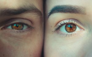 Two individuals stand next to each other with the camera zoomed in on their eyes. This illustrates a concept of EMDR therapy in Colorado Springs, CO with Altitude Counseling. You can get help from a emdr therapist in colorado springs, co in online therapy in Colorado, too.