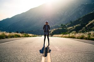 A person stands in a street. They are feeling empowered since beginning ptsd treatment in Colorado with Altitude Counseling in Colorado Springs, CO 80907.