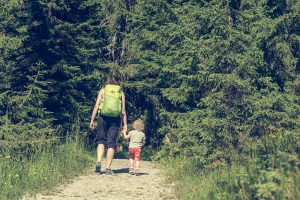 A mother and daughter walk into the woods. They are feeling much better since starting counseling for childhood emotional neglect in Colorado Springs, CO with Altitude Counseling.