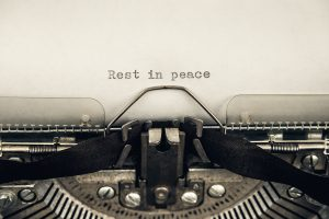 """A type writer spells out """"rest in peace."""" This reflects concepts discussed in grief counseling in Colorado with Altitude Counseling."""