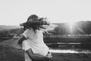 A couple embraces each other. They are feeling happy since starting couples counseling in Colorado Springs, CO with Altitude Counseling.